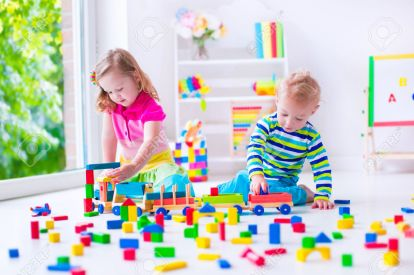40446113-Kids-play-at-day-care-Two-toddler-children-build-tower-of-colorful-wooden-blocks-Child-playing-with--Stock-Photo.jpg